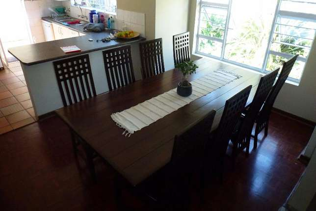 10 seater solid wood dining room table and chairs Parkmore - image 3