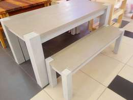 Solidwood dining table with benches.