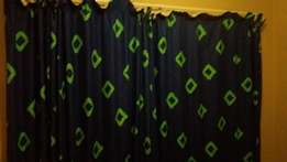Blue curtains with green squares