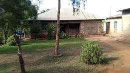 House for sale on half acre in Gayaza Manyangwa behind tarmac 110m