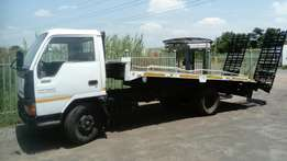 Mitsubishi Canter low bed for vehicle transport.