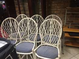 8 Cane Chairs with Cushions