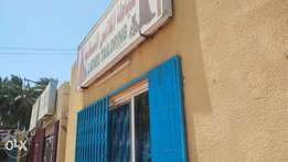 Good looking Tailor shop for sale with room behind it