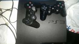 Playstation 3 with 2 games 2 controls