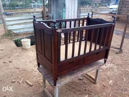 Baby cot with drawers