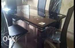 High class open padded glass dining table