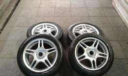 """15 """" rims with tires 114 pcd fits mazda or ford R2500 neg"""