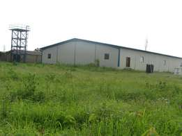 2acres of land with new warehouse for sale at sango ota,Ogun state.