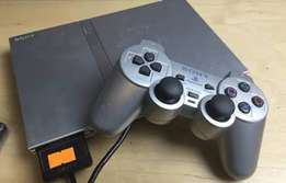 PlayStation 2 with 10 games and 3 remotes
