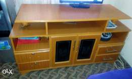 Tv stand with storage drawers.