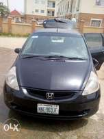 Clean sport Honda fit, automatic gear, full AC, new tires, used by wom