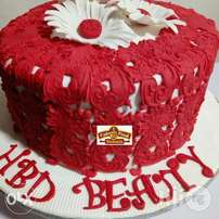 Red Is Beauty,With A Sunflower At The Top Of A Vanilla Chocolate Cake