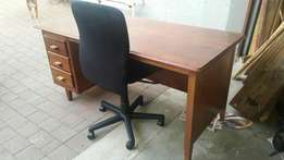 Large wooden desk and office chair