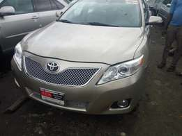 Toks 2010 gold Toyota camry with navigation and thumb start