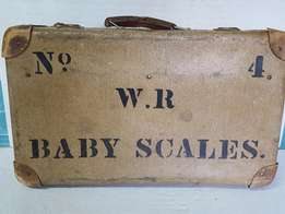 Vintage Baby Scale in suitcase, used by travelling clinics.