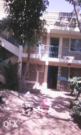 Land with houses for sale Kayole - image 1