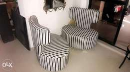 A pair of Unique black and white stripe pattern fabric chairs