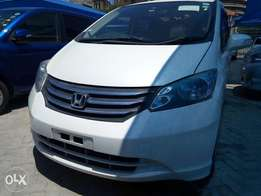 Honda Freed pearl white colour 7 seater .