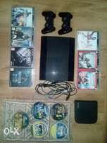 500GB Ps3 console + 12 games + 2controllers and all cables.