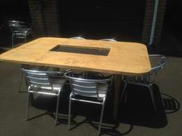 Strong wood table with chairs for sale.