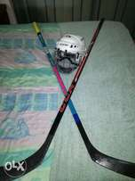 2 ice hokkey stick and helmet