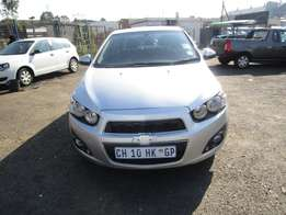Finance available for 2013 Chevrolet Sonic ,silver in color ,4 doors