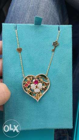 Himo Gold, Diamond and Ruby lucky charm necklace