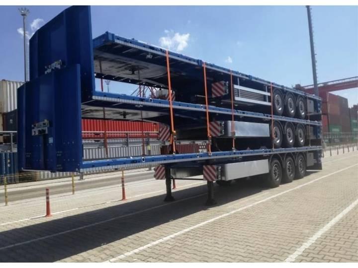 Nieuwe vlakke trailers voor bouw, staal en transport - 1900