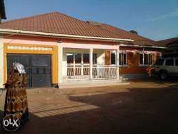 Located in Bweyogerere seated on 100by100 ,it has 3 bedrooms , boys q