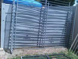 Two galvanised burglar bars