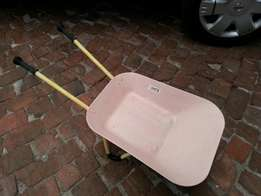 Kiddies iron wheelbarrow.