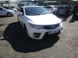 Finance available for 2011 Kia Cerato coup, white in color , 4 doors