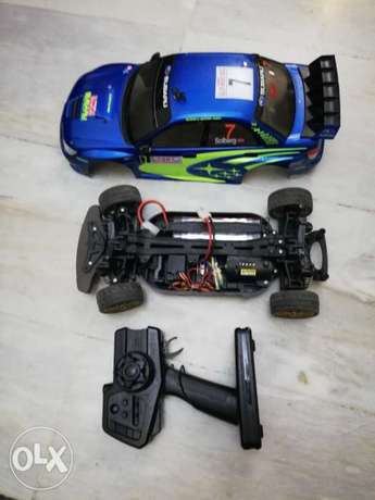 اتبادل على تلفزيونTamiya tt01 subaru impreza used in exelentcondition