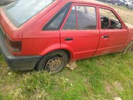 Mazda 323 sting stripped for parts