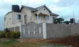25 by 50 plot with title on kenyatta road.
