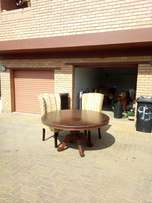 Round oak table plus 7 x chairs