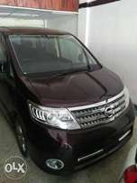 Nissan Serena red wine colour fully loaded.