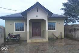 3 bedroom bungalow finished on a plot of land fenced with water.