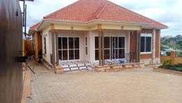 brand new 4bedrooms,3bathrooms standalone in kira at 2.5m negotiable