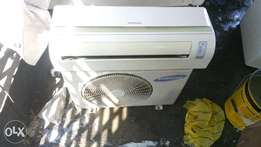 Samsung 1hp Split unit AC used by a white man
