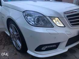 Mercedes Benz E250 AMG sport package - White with Glass roof
