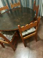 Wooden dining table with six chairs for sale