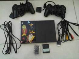 Playstation 2 with 2 controllers and 11 video games with 1 memory card