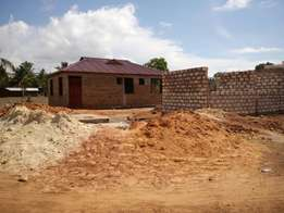 Prime Plots for sale in fast developing zone of Utange near Wema Centr