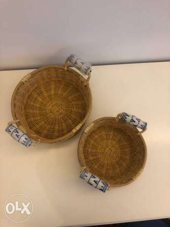 Set of 2 straw baskets with hand painted handles
