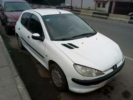 ADORABLE MOTORS: A clean well used Peugeot 206