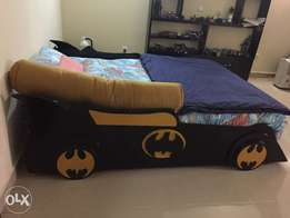 Batman bed, table and a shelving unit for sale