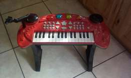 Selling a child piano needs batteries make an offer
