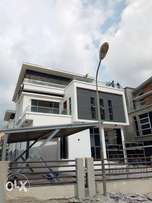 mansion with a swimming pool for sale in pinnock Estate Osapa