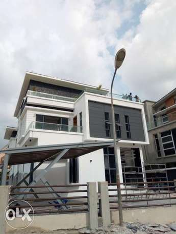 mansion with a swimming pool for sale in Osapa London Lekki - image 1